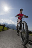 Mountain biker with sun Royalty Free Stock Photography