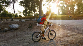 Mountain biker in sunbeams Royalty Free Stock Photos