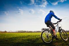 Mountain biker on sunny day Stock Image