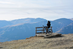 Mountain biker on top Royalty Free Stock Photo