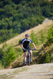Mountain biker on trails Royalty Free Stock Photos
