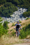 Mountain biker on trails Royalty Free Stock Image