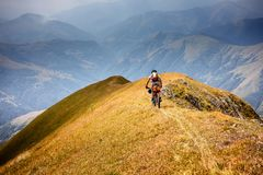 Mountain biker is travelling in the highlands of Tusheti region,. Georgia Royalty Free Stock Image