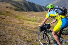 Mountain biker is travelling in the highlands of Tusheti region,. Georgia Stock Images