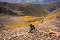 Mountain biker is travelling in the highlands of Tusheti region,. Georgia Royalty Free Stock Photography