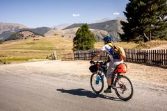Mountain biker is travelling in the highlands of Tusheti region,. Georgia Royalty Free Stock Images