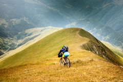 Mountain biker is travelling in the highlands of Tusheti region,. Georgia Stock Photo