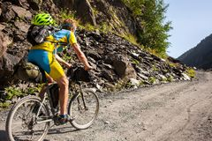 Mountain biker is travelling in the highlands of Tusheti region,. Georgia Royalty Free Stock Photos