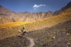 Mountain biker is travelling in the highlands of Tusheti region,. Georgia Stock Photography