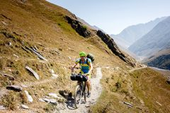 Mountain biker is travelling in the highlands of Tusheti region,. Georgia Royalty Free Stock Photo
