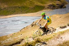 Mountain biker is travelling in the highlands of Tusheti region,. Georgia Stock Image