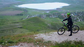 Mountain Biker Travelling At Hilly Terrain stock video footage