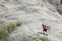 Mountain biker uphill Royalty Free Stock Photos