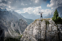 Mountain Biker in Victory Pose royalty free stock photos