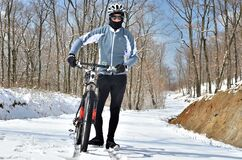 Mountain biker in winter snow