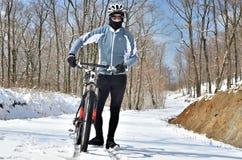 Mountain biker in winter snow