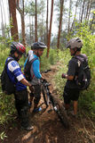 Mountain bikers. Mountain biker was traveling cross-country in a village in Salatiga, Central Java, Indonesia Stock Image