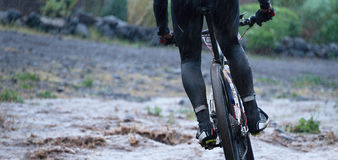 Mountain bikers driving in rain Royalty Free Stock Images