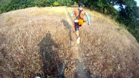 Mountain bikers in extreme sport race stock footage