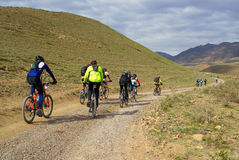 Mountain bikers group racing in desert Royalty Free Stock Photography