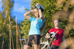 Mountain Bikers Having Rest  in Summer Forest Stock Photography
