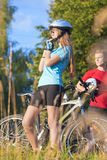 Mountain Bikers Having Rest  in Summer Forest Royalty Free Stock Image