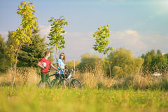 Mountain Bikers Having a Stroll in Summer Forest. Horizontal Image Royalty Free Stock Photos