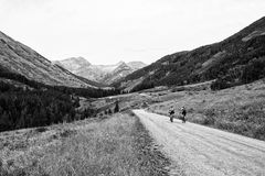 Mountain Bikers ride into the mountains Stock Photo