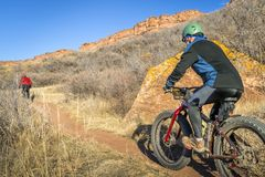 Mountain bikers riding trail at Colorado foothills Stock Photography