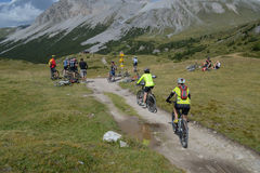 Mountain bikers riding though Swiss mountain area Stock Photo