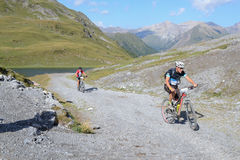 Mountain bikers riding though Swiss mountain area Stock Images