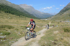 Mountain bikers riding though Swiss mountain area Royalty Free Stock Image