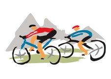 Mountain bikers riding the trail Stock Photos