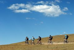 Mountain bikers on rural road Royalty Free Stock Photos