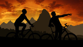 Mountain bikers. Silhouette in sunset Royalty Free Stock Photo