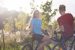 Mountain Bikers Standing and Resting in Forest Surroundings Stock Photography