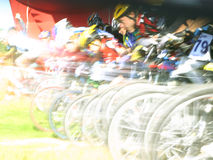 Mountain bikers on a start. Mountain bikers on a  start, motion blur Royalty Free Stock Images
