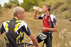 Mountain Bikers Taking a Break Stock Photo