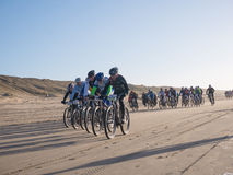 Mountain bikers taking part in the beach race Egmond-Pier-Egmond Royalty Free Stock Images