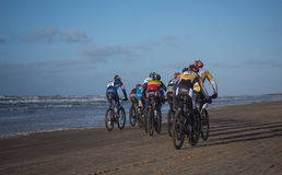 Mountain bikers taking part in the beach race Egmond-Pier-Egmond Royalty Free Stock Image