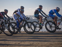 Mountain bikers taking part in the beach race Egmond-Pier-Egmond Royalty Free Stock Photos