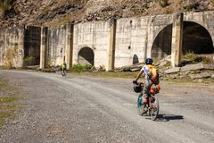 Mountain bikers are travelling in the highlands of Tusheti regio. N, Georgia Royalty Free Stock Image