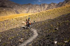 Mountain bikers are travelling in the highlands of Tusheti regio. N, Georgia Royalty Free Stock Images