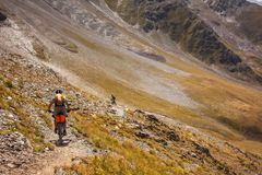 Mountain bikers are travelling in the highlands of Tusheti regio. N, Georgia Stock Images