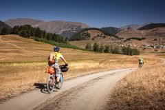 Mountain bikers are travelling in the highlands of Tusheti regio. N, Georgia Royalty Free Stock Photo