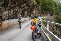Mountain bikers are travelling in the highlands of Tusheti regio. N, Georgia Royalty Free Stock Photography