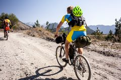 Mountain bikers are travelling in the highlands of Tusheti regio Royalty Free Stock Images