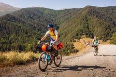 Mountain bikers are travelling in the highlands of Tusheti regio. N, Georgia Stock Photo