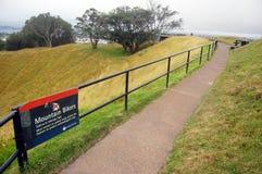 Mountain bikers walking path park sign stock photos