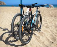 Mountain bikes on the beach Stock Image